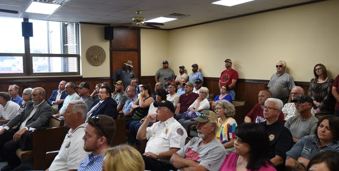A large influx of City of Mountain Home employees helped pack the Mountain Home City Council meeting to near standing-room-only conditions on Thursday night. The city is facing a $400,000 increase in its health insurance premiums.