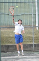 Mountain Home's Satch Harris serves on Thursday against Searcy.