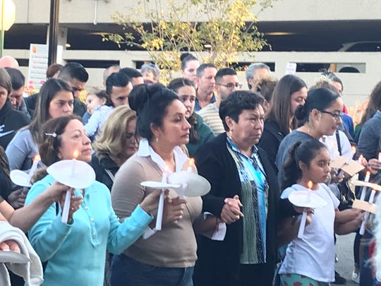 Dover community members hold hands during prayer vigil for Steven Gomez-Restrepo as he remains critical at Morristown Medical Center ICU.