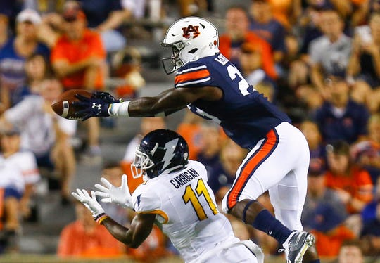 Auburn defensive back Roger McCreary (23) tries to intercept a pass intended for Kent State wide receiver Mike Carrigan (11) on Saturday, Sept. 14, 2019, in Auburn, Ala.