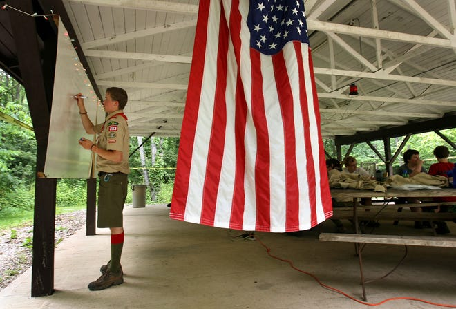 A Senior Patrol Leader prepares the lesson for his troop as they and other Boy Scouts are in the middle of National Youth Leadership Training at Camp Red Wing in this photo from 2008.