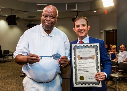 Longtime community volunteer John Verge, left, holds a key to the city he received from Murfreesboro Mayor Shane McFarland, who is holding the official proclamation at a presentation made during a City Council meeting Thursday evening.