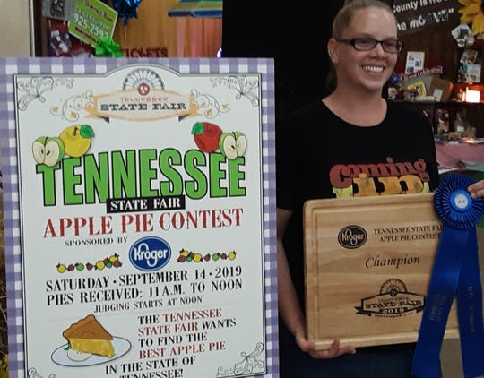 Samantha Sortino of Murfreesboro stands with the blue ribbon she won at the 2019 Tennessee State Fair for her apple pie recipe.