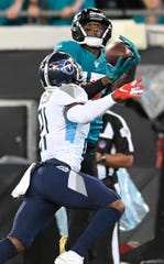 Jacksonville Jaguars wide receiver D.J. Chark (17) pulls in a touchdown catch against the Tennessee Titans during the first quarter at TIAA Bank Field Thursday, Sept. 19, 2019 in Jacksonville, Fla.