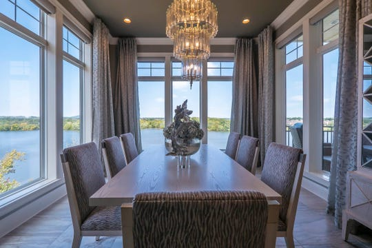 The dining area has an unobstructed view of Old Hickory Lake. There are chandeliers throughout the condo.