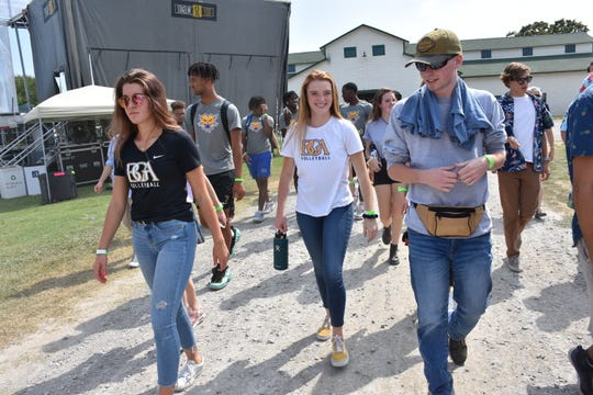 Libby McConnell, Olivia Bevins, and Drew Lamb tour the grounds of Pilgrimage Music & Cultural Festival on Friday as part of Community Day.