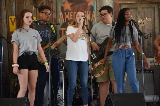 Singers Chloe Drugeot, Olivia Bevins and Kendall Grimes perform as part of the Battle Ground Academy Contemporary Music Ensemble during Pilgrimage Community Day.
