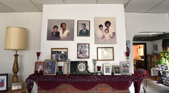 Family photos above the mantel in the Blake family home on Newark's South Side. The home had been a barbecue restaurant known as Mattie's Place run by Jeremy Blake's grandmother, Mattie Blake.