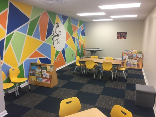 With nearly 10,000 square feet of space, there are many special rooms school leaders say, including this media room with smart table.