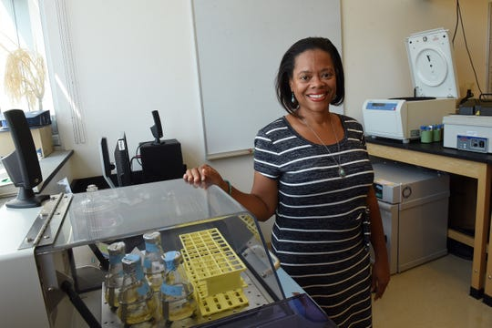 Ayana Hinton, an associate professor of biology at Denison University, with a shaker in one of the labs. The shaker was preparing E. coli samples for senior level research students to extract DNA from.