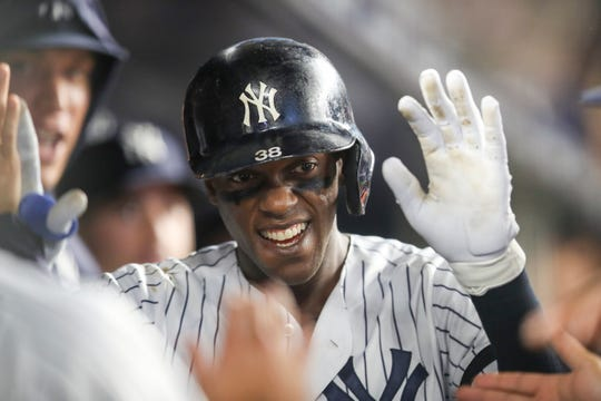 New York Yankees' Cameron Maybin celebrates after hitting a home run during the eighth inning of a baseball game against the Los Angeles Angels, Thursday, Sept. 19, 2019, in New York.