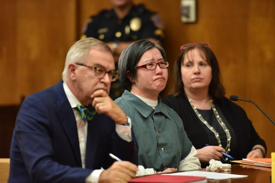 Jenny Tran is sentenced to 16 years for smothering her ailing husband with a plastic bag in 2011 before Bergen County Superior Court Judge Margaret Foti in Hackensack, N.J. Friday Sept. 20, 2019. Her original sentence of 50 years was over turned upon appeal.