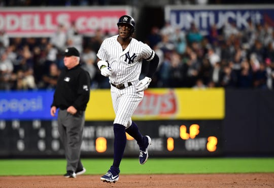 Cameron Maybin #38 of the New York Yankees runs the bases after hitting a home run in the eighth inning of their game against the Los Angeles Angels at Yankee Stadium on September 19, 2019 in New York.
