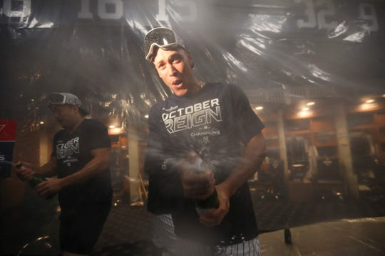 New York Yankees' Aaron Judge celebrates after the Yankees defeated the Los Angeles Angels and clinched the AL East title Thursday, Sept. 19, 2019, in New York.