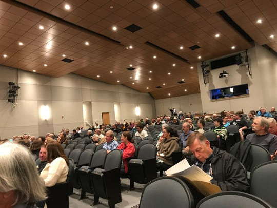 West Milford residents gather in the town's high school auditorium on Sept. 19, 2019 to hear a controversial proposal to expand an organic recycling center near the Monksville Reservoir.