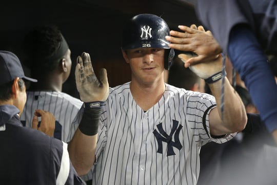 Sep 19, 2019; Bronx, NY, USA; New York Yankees second baseman DJ LeMahieu (26) celebrates his three run home run against the Los Angeles Angels in the dugout with teammates during the second inning at Yankee Stadium.