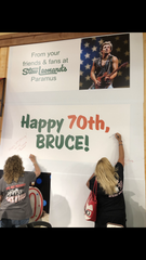 Fans sign the birthday card. Fans gathered to celebrate Bruce Springsteen's birthday at Stew Leonard's in Paramus Park Mall.