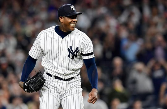Aroldis Chapman #54 of the New York Yankees celebrates after throwing a strike out to win 9-1 over the Los Angeles Angels at Yankee Stadium on September 19, 2019 in New York.