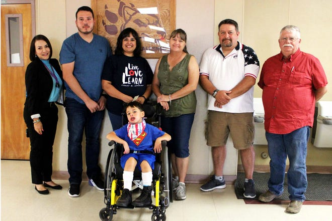 From left to right, Sunrise Elementary Principal Dora A. Solis, Oscar Molina, Cecilia Sidwell, Kim Hickox, Patrick Hickox, Lee Morris, and Nathaniel (third-grader with Cerebral Palsy).