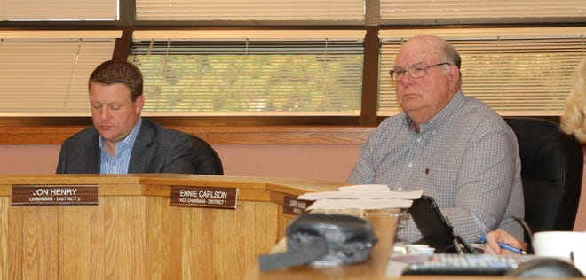 District 2 County Commissioner Jon Henry (left) and District 1 County Commissioner Ernie Carlson during a Sept. 17 meeting in Carlsbad. Commissioners were briefed on continued talks between Eddy County and the Village of Loving for fire protection.