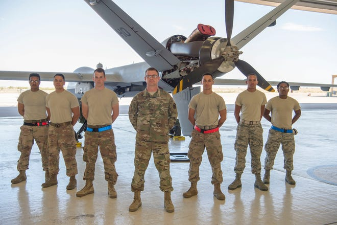 Master Sgt. Cody Biorn, (center), 49th Aircraft Maintenance Squadron productions superintendent, poses with 49th AMXS and 9th Aircraft Maintenance Unit crew chiefs, Sept. 11, 2019, on Holloman Air Force Base, N.M. Biorn was awarded the 2019 General Lew Allen Jr. Award at the Air Education and Training Command-level, which recognizes Airmen for their outstanding accomplishments in aircraft, munitions, or missile maintenance.