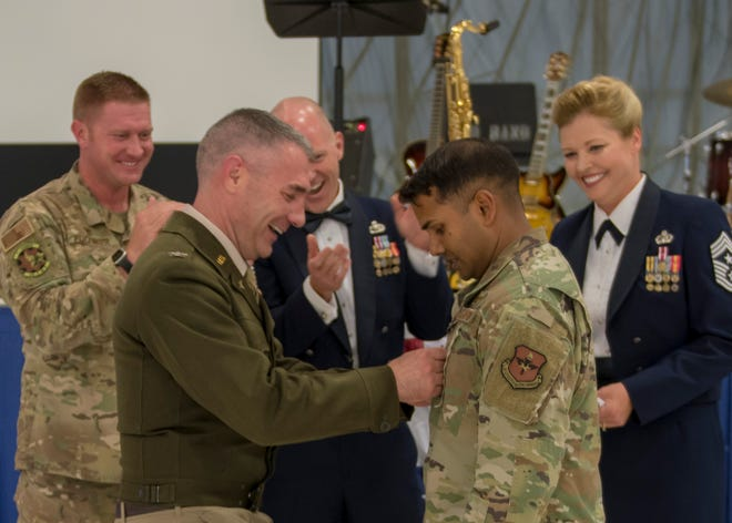 Col. Joseph Campo, 49th Wing commander, pins on rank for newly promoted Tech Sgt. Denzel Ramdhanie, 49th Component Maintenance Squadron avionics back shop production non-commissioned officer in charge at the Air Force Ball, Sept. 14, 2019, on Holloman Air Force Base, N.M. Ramdhanie promoted from staff sergeant to technical sergeant through the Stripes for Exceptional Performers program.