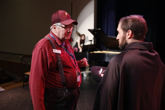 "Director Randy West, left, confers with cast member Matthew Aaron during a Sept. 19 rehearsal for ""The Musical of Musicals (The Musical!)"" at the Farmington Civic Center."