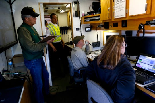 Emergency officials from various agencies work inside the Farmington Police Department's mobile command unit on Wednesday, Sept 14, 2016 at a ConocoPhillips facility in Farmington.