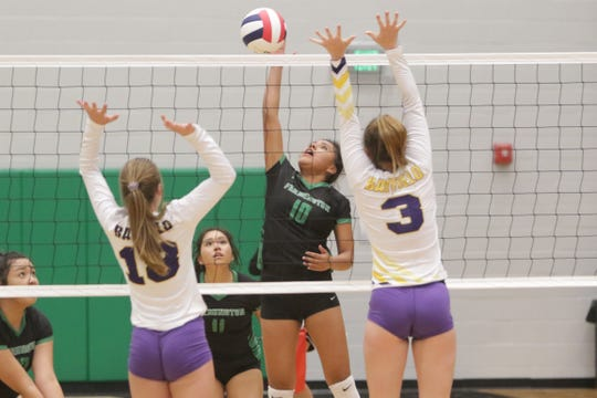 Farmington's Carolyn Thomas hits the ball over the net against Bayfield during Thursday's volleyball match at Scorpion Arena in Farmington.