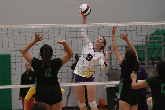 Bayfield's Emily Nelson hits the ball down the side against Farmington during Thursday's volleyball match at Scorpion Arena in Farmington.