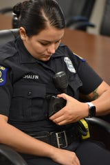 Westland Police Deptartment Officer Summer Chalfin attaches her Axon body camera to her uniform during a Sept. 20 training session.