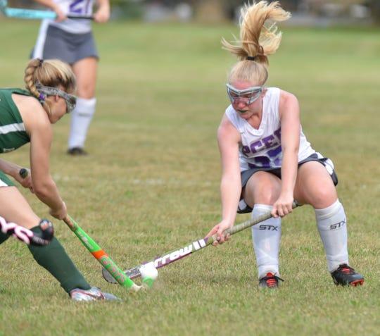 PCEP's Olivia Koogiena, right, plays field hockey on Sept. 20.