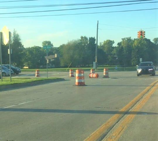 The intersection of Six Mile and Beck roads in Northville Township is being prepped for a major construction project.