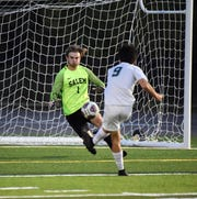 Novi's Odin Lim fires a shot past Salem goalie Chris Pohl to give Novi a 2-0 lead.