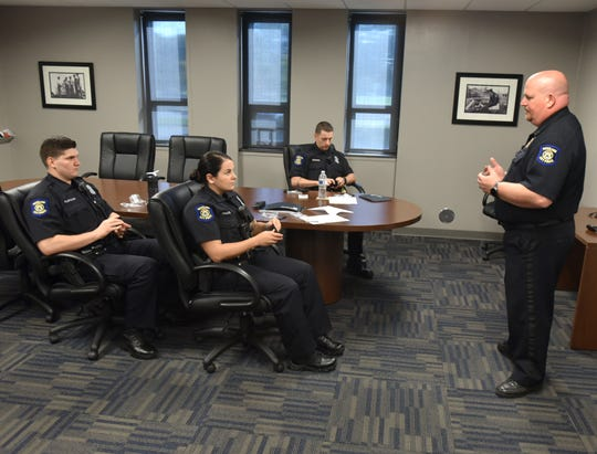 New Westland Police Department Officers Cameron Plofchan, left, Summer Chalfin, and Peter Bednarz are instructed by Lt. Steve Bird, right, on the proper use of their new Axon body cameras during a Sept. 20 session at the Ford Road department.