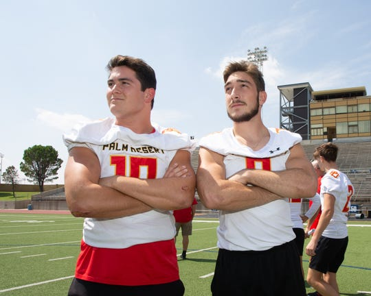 Palm Desert High running back Simon Gaete (left) and teammate John Mitchell pause and look around 19,000-seat Ratliff Stadium on Sept. 20, 2019, where the Aztecs will play Permian High later in Odessa, Texas.