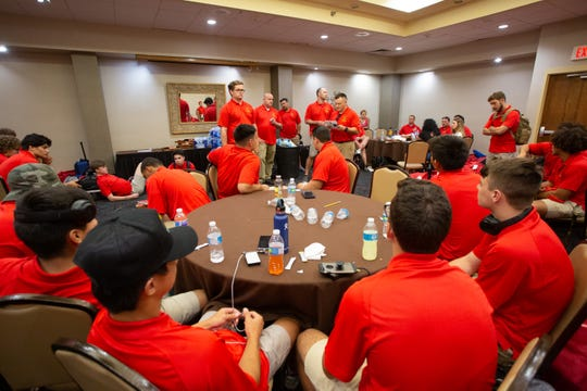 Members of the Palm Desert High School football team enjoy some pizza in a ballroom at the Best Western-El Paso after arriving in El Paso, Texas, on Sept. 19, 2019. The Aztecs will play Permian High School on Friday night.