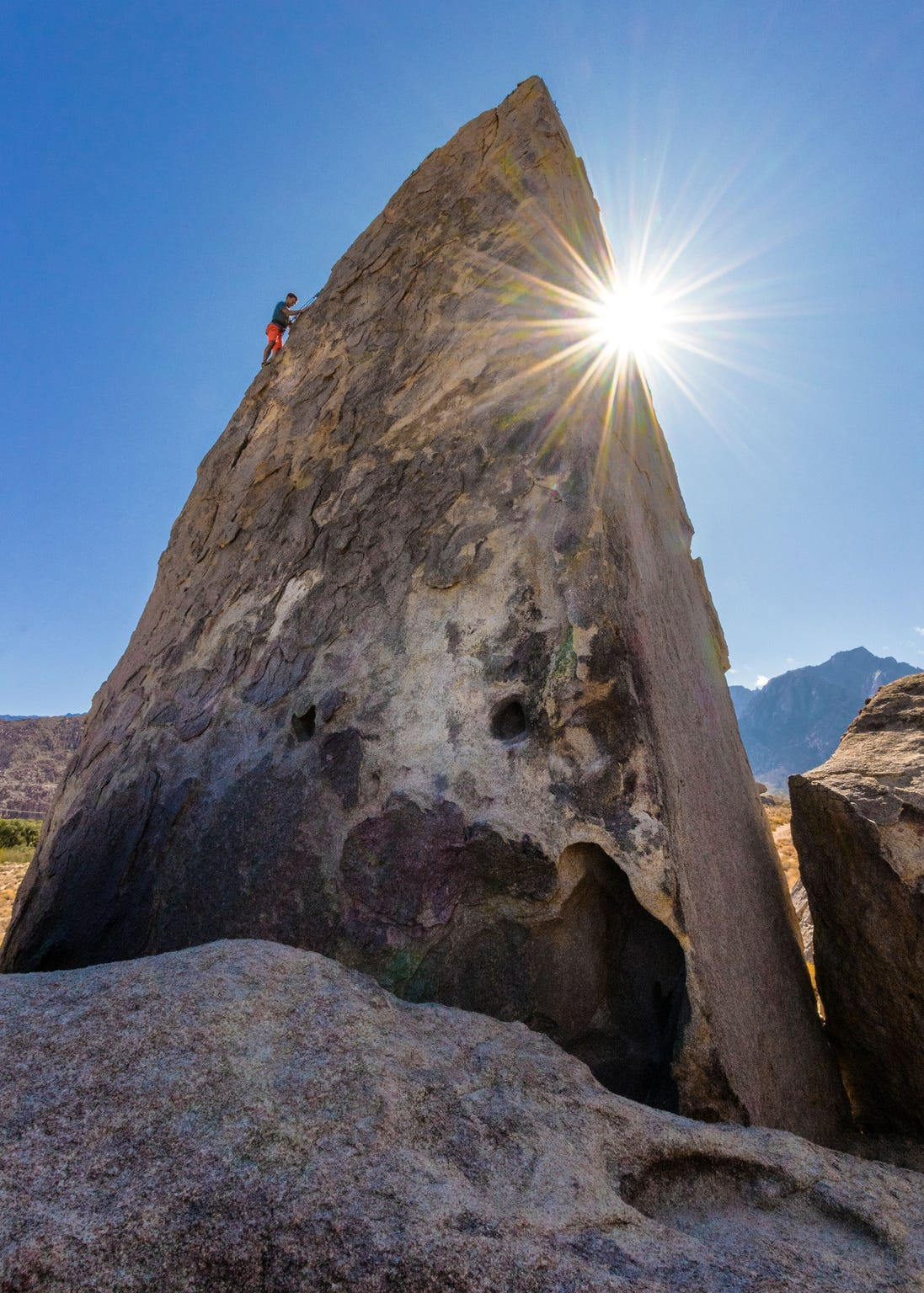 A climber on the Shark's Fin Arete in Alabama Hills.