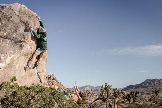 Joshua Han climbs Swinging Richard in Joshua Tree National Park.