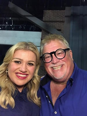 Brian Ingelson poses with Kelly Clarkson.
