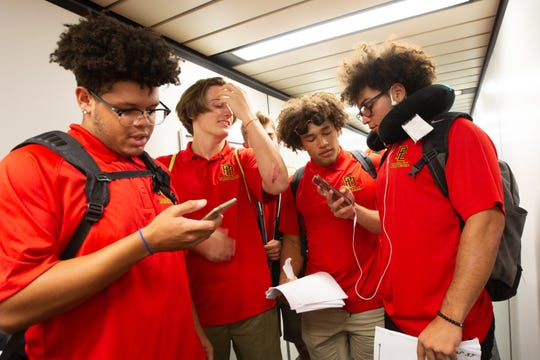 Members of the Palm Desert High football team board an airplane at Ontario International Airport on Sept. 19, 2019, for a flight to Texas. The Aztecs will play a football game on Friday in Odessa, Texas.