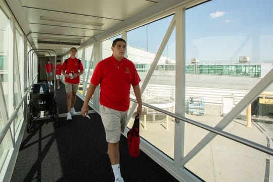 Palm Desert High senior lineman Daryne Murillo  gets ready to board the airplane  at Ontario International Airport on Sept. 19, 2019, for a flight to Texas. The Aztecs will play a football game on Friday in Odessa, Texas.