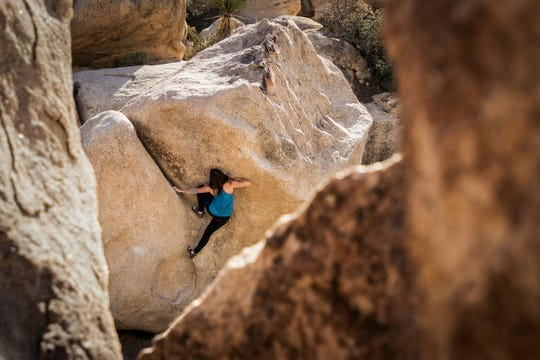 Christina Pilo Gargle climbs a boulder in Joshua Tree National Park.