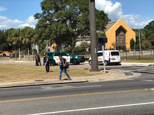 Escambia County Sheriff's Office vehicles are parked Friday at the intersection of Shoemaker Street and Mobile Highway in front of the Brownsville Assembly of God Church, a short distance away from Green Street where authorities say one man was shot.