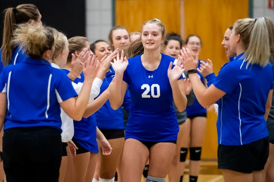 Spring Grove's Skye Wolfe high-fives her teammates as she is introduced prior to a game against South Western in Hanover on Thursday, September 19, 2019. The Lady Rockets fell in four sets.