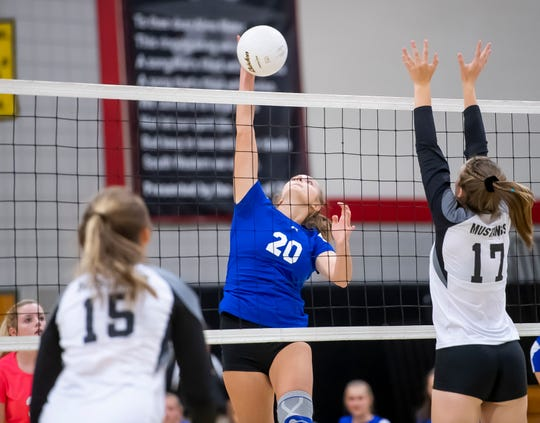 Spring Grove middle hitter Skye Wolfe hits the ball over the net during a YAIAA Division I volleyball match against South Western on Sept. 19. The Lady Mustangs prevailed in four sets, 25-20, 23-25, 25-22, 25-13.