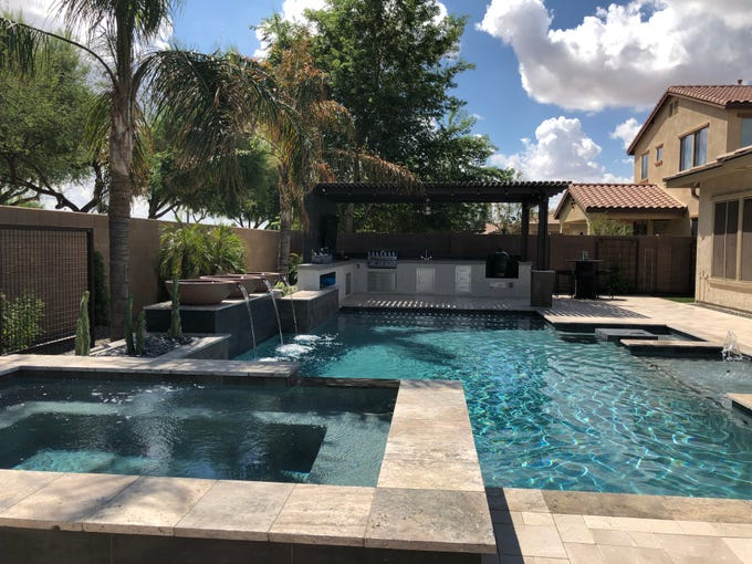 Kevin and Sara Felix's dream backyard in their south Chandler home is complete with pool, spa, sports bar, barbecue area and lots of mingling spots.