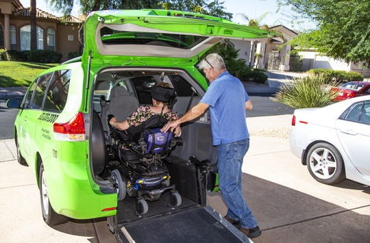 Michelle Murik uses a motorized wheelchair full-time and used to rely on Dial-A-Ride to get to her job. Murik, who has cerebral palsy, now has to depend on another service called RideChoice. She is loaded into the van to take her to work, Friday, September 20, 2019.