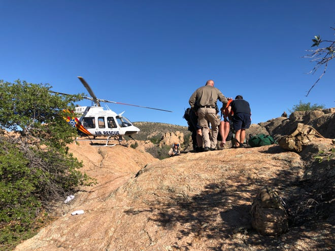 Rescuers on Sept. 19, 2019, tend to a hiker who had become stranded on a trail near Prescott for two nights before being found.