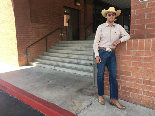 Rancher Alexander Khan, 24, is a Brophy College Preparatory grad and heading to law school soon. His family just bought a cattle ranch near Perkinsville, northwest of Cottonwood.
